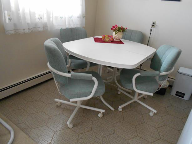 kitchen table and four swivel chairs table extension