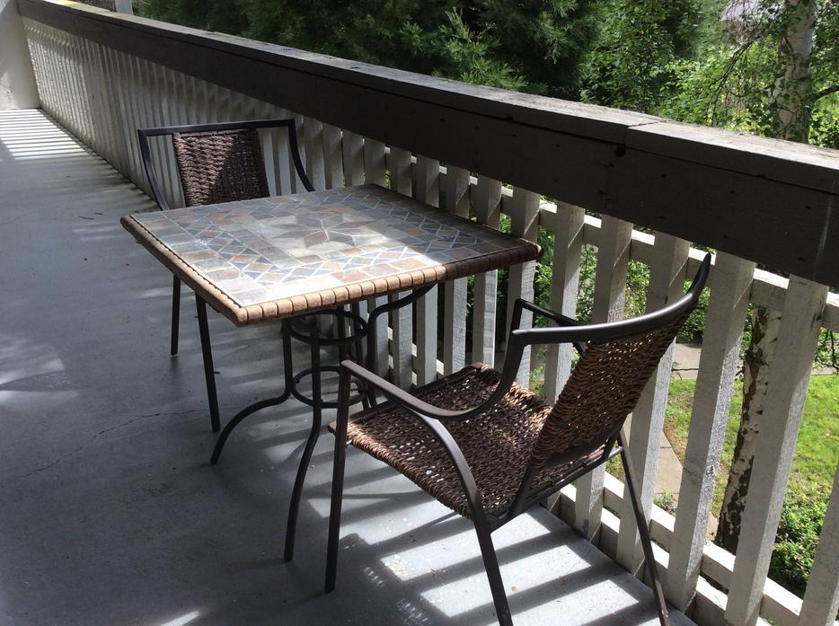 patio table with ceramic tile top and two chairs