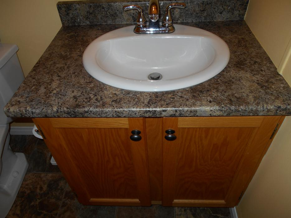 USED 30 INCH OAK VANITY WITH SINK & TAPS PRINCE COUNTY, PEI