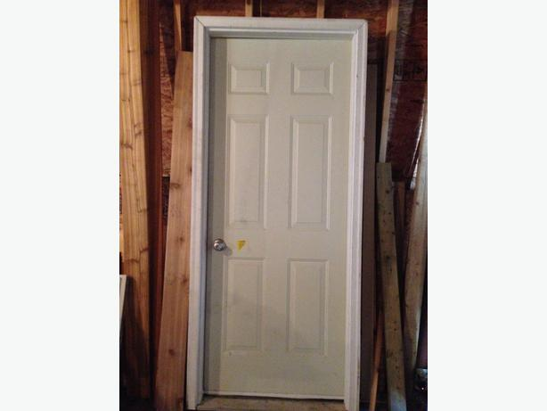Insulated metal exterior door central regina regina for Insulated entry door