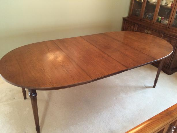 Solid wood formal dining room table with 2 leaves south for Formal wood dining table