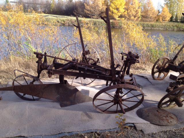 Antique plows yard lawn garden decor rural regina regina for Lawn and garden decorative accessories