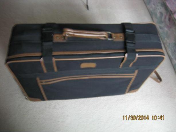 suitcase on 4 wheels in mint shape