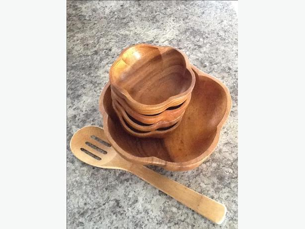 Wooden salad bowl and four wooden serving bowls