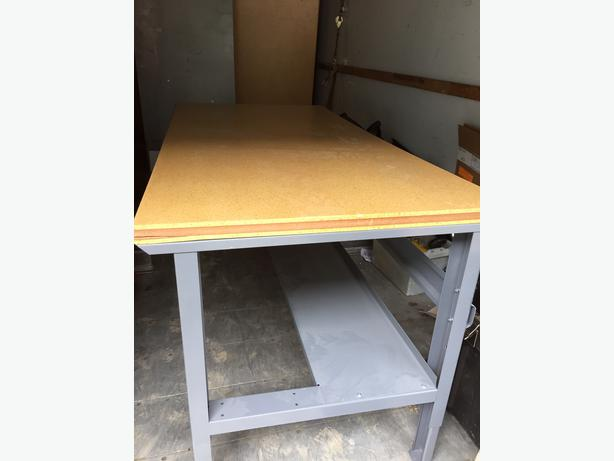 Work Bench(s) with Wood and Metal tops (Surfaces), all frames etc. are metal.