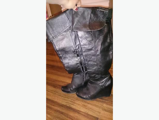 Selling black high-heel boots