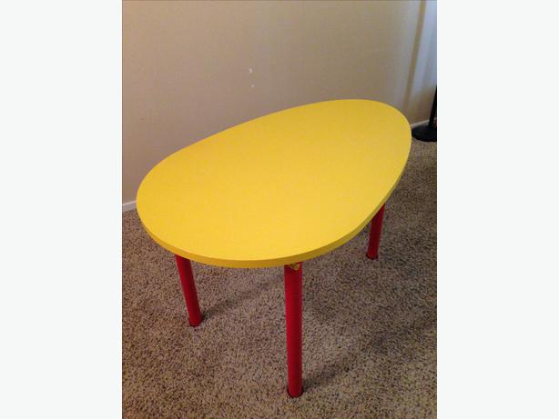 Yellow and Red IKEA Egg-shaped Table
