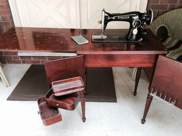 antique singer sewing machine in wood cabinet