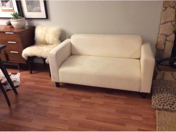 we have an apartment size white sofa from a clean no smoking home