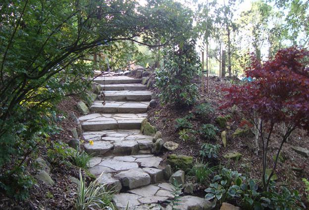 Affordable landscape stonework paving ponds more for Affordable landscaping