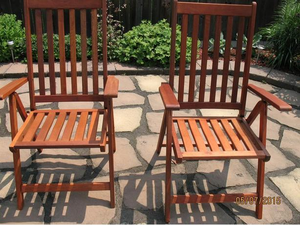Two solid teak folding patio armchairs