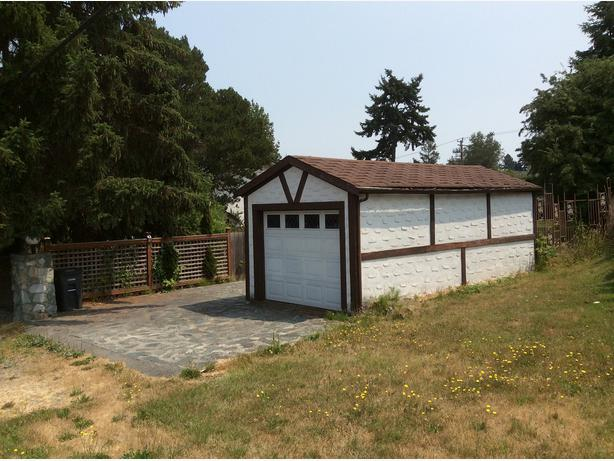Cozy two storey house with separate garage saanich for Separate garage