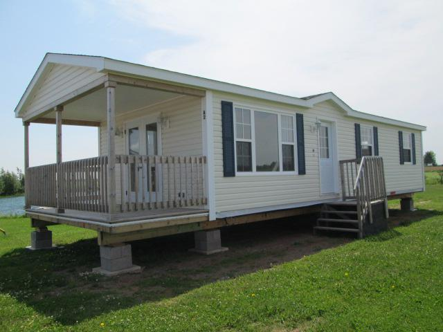 Cottage style mini home kensington pei for Pei home builders