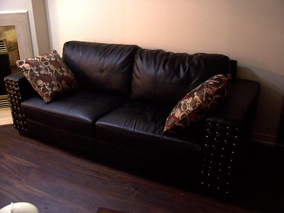 Stylish large black and silver studded leather sofa for for Leather studded couch
