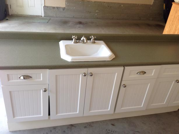 one lower cabinet with sink and counter top in excellent condition