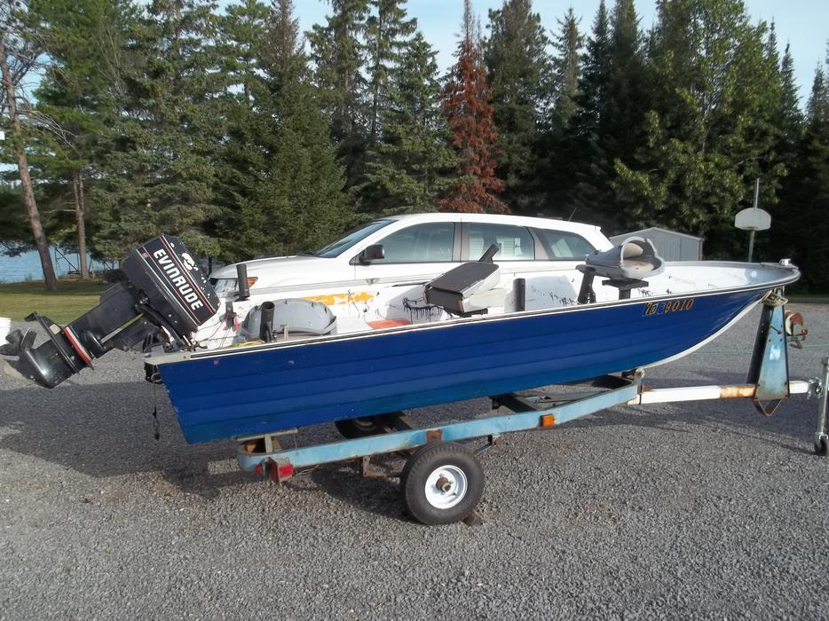 Sold Sold Fishing Boat With Motor And Trailer Outside