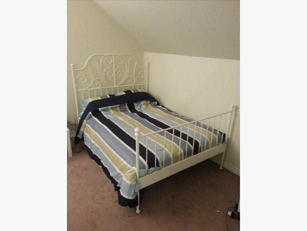 two month old double wrough iron bed plus mattress for