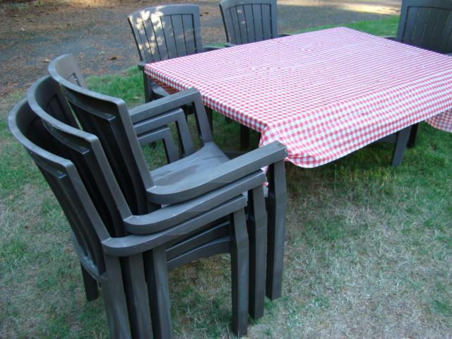brown resin patio table and six chairs outside comox valley courtenay