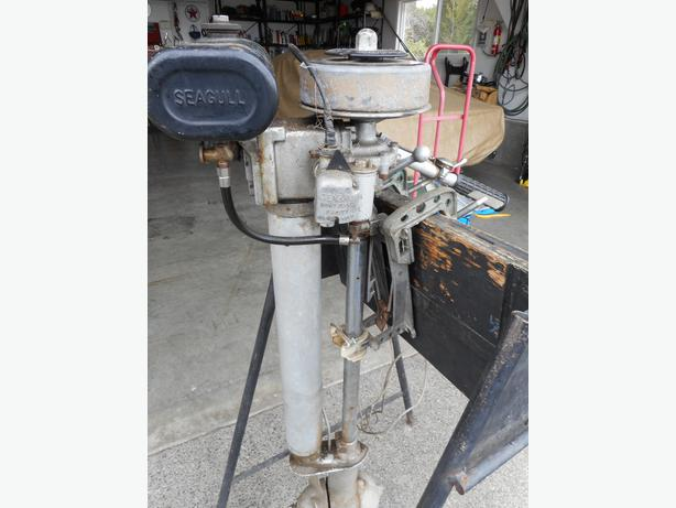 Old Seagull Running Outboard Motor For Sale Outside