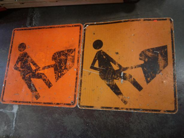 Old Construction Sign; Guy Shovelling