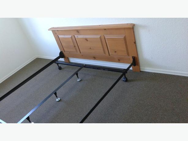 queen size wooden head board and cast iron bed frame central
