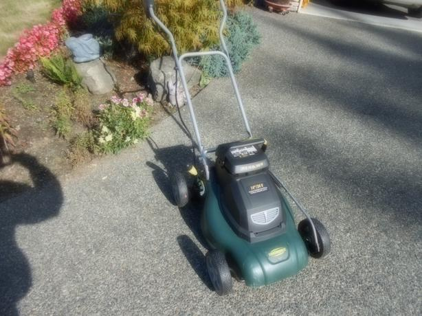 Cordless Electric Lawn Mower Outside Nanaimo Parksville