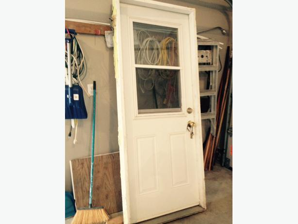 32 INCH STEEL EXTERIOR DOOR WITH WINDOW AND SCREEN, LEFT HINGE, $75