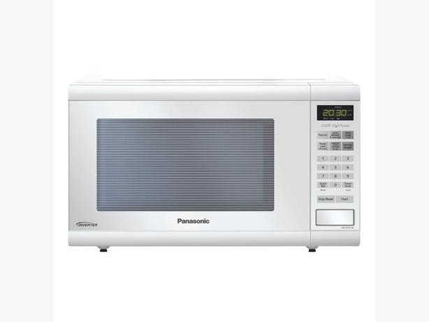 1200W  Model NN-S615F  Lightly used in an executive condo rental for    Used White Microwave