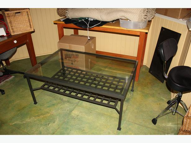 Great condition glass top black metal coffee table with lower shelf