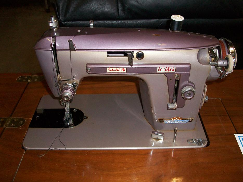 was 75 woollcrest sewing machine with cabinet for sale at st vincent de paul saanich victoria. Black Bedroom Furniture Sets. Home Design Ideas