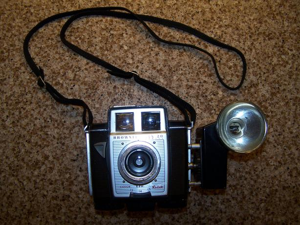 Brownie Camera with strap, flash component, bulbs and film