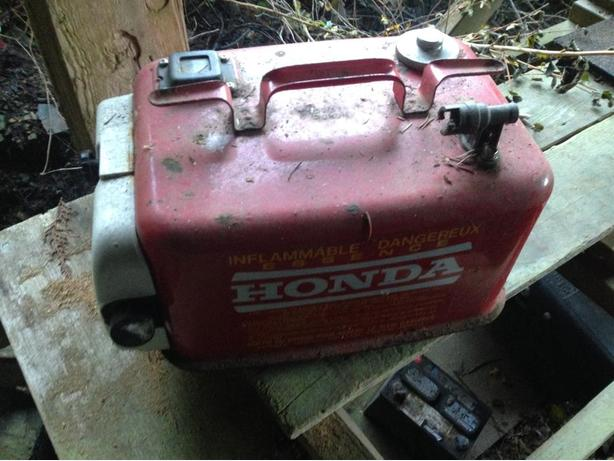 Honda gas tank with attached oil bottle