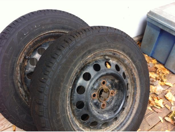 Four 185/65R14 Goodyear Winter tires on rims (NEW PRICE)