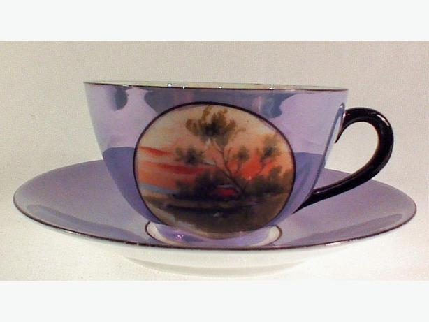 Handpainted lustre teacup and saucer