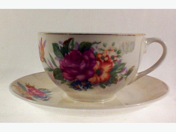 Handpainted floral lustre teacup & saucer