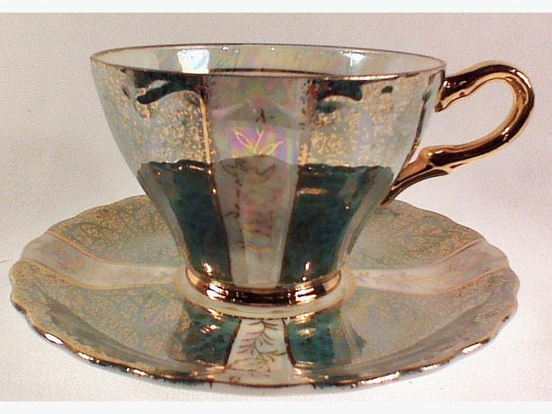 Teal lustre teacup and saucer