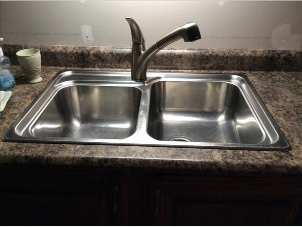 Double kitchen sink with Moen Faucet