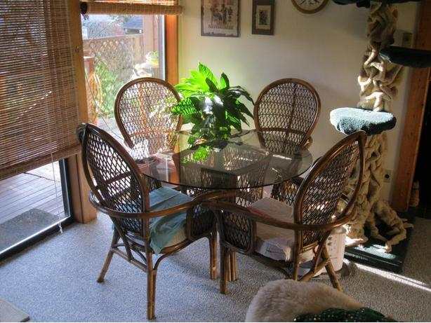 Round Glass Table With Rattan Chairs for breakfast nook, sunroom, etc