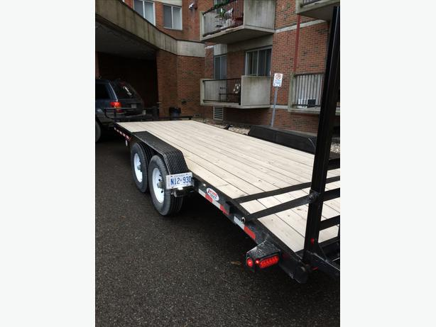 A  cheap towing service Flatbed