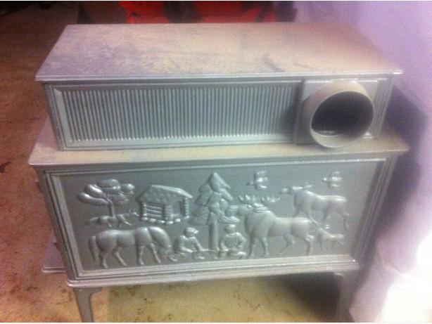 Rare old embossed caboose woodstove WITH MOOSE AND CABIN SCENE!