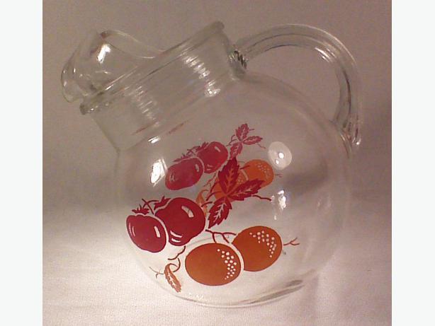 Glass ball pitcher ice lip