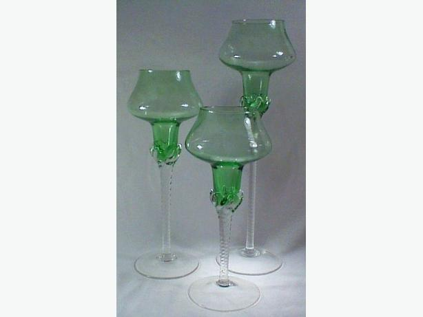 Glass candleholders or vases