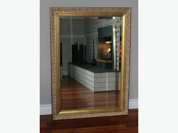 Wall Mirror with beveled mirror glass and gold frame