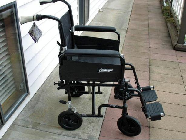 LIKE NEW LIGHT WEIGHT AIRGO TRANSPORT WHEELCHAIR FOR SALE