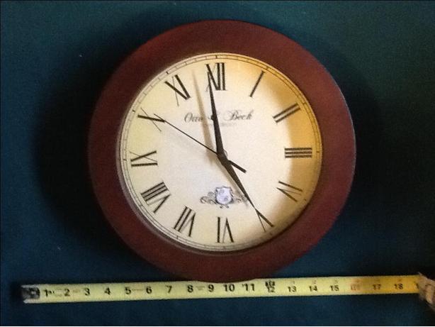 Round brown framed clock