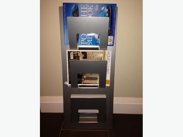 "IKEA Magazine rack, silver color, 13x3 ½x30 ¾ "" $16.99"