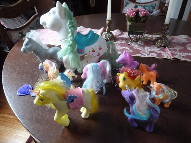 Collection of 13 horses and unicorn and mane brush
