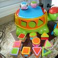 Fisher-Price Peek A Blocks Build and Spill Musical Turtle and tractor