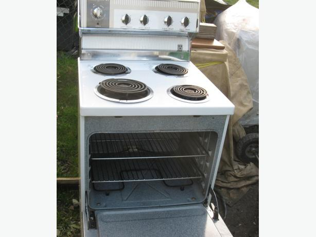 Apartments size electric stove G E 24 inches wide as pictured ...