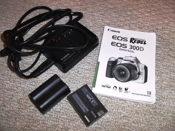 EOS Rebel Charger and 2 Batteries